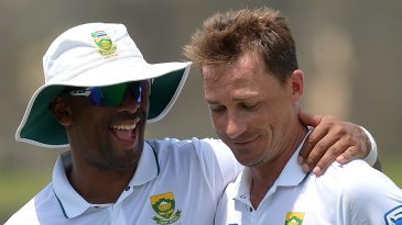Dale Steyn gets a congratulatory embrace from Vernon Philander upon becoming South Africa's joint leading wicket-taker