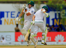 Aiden Markram and Dean Elgar try to avoid a collision while running between the wickets Sri Lanka v South Africa, 1st Test, Galle, 3rd day, July 14, 2018