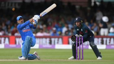MS Dhoni gets down on a knee to hammer one