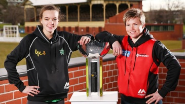 Makinley Blows and Jess Cameron pose with the WBBL trophy