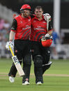 Tom Latham walks off the field alongside team-mate Stuart Poynter, Notts Outlaws v Durham, Vitality Blast, North Group, Trent Bridge