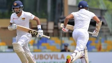 Dimuth Karunaratne and Danushka Gunathilaka run between the wickets