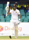 Dimuth Karunaratne raises his bat after reaching a half-century, Sri Lanka v South Africa, 2nd Test, Colombo, 1st day, July 20, 2018