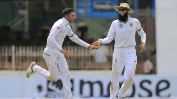 Keshav Maharaj and Hashim Amla celebrate a wicket