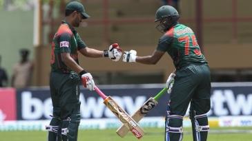 Tamim Iqbal and Shakib Al Hasan punch gloves during their 207-run partnership