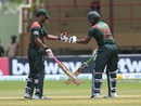 Tamim Iqbal and Shakib Al Hasan punch gloves during their 207-run partnership, West Indies v Bangladesh, 1st ODI, Guyana, July 22, 2018