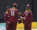 Devendra Bishoo, Alzarri Joseph and Shimron Hetmyer celebrate a wicket, West Indies v Bangladesh, 1st ODI, Guyana, July 22, 2018