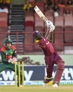 Alzarri Joseph steps out to hit a six while Mushfiqur Rahim watches on, West Indies v Bangladesh, 1st ODI, Guyana, July 22, 2018