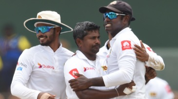 Rangana Herath celebrates a wicket with his team-mates