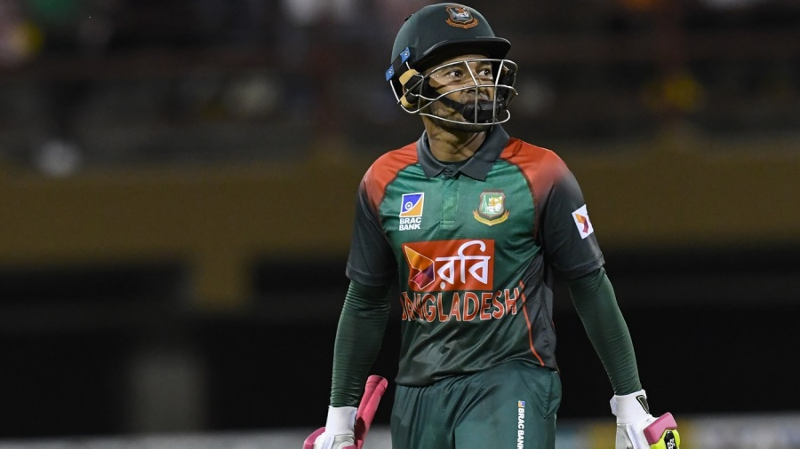 A disappointed Mushfiqur Rahim walks back