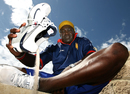 Gladstone Small pours out sand from his shoes during a beach cricket game in Perth,