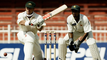 In a match in Sharjah in which Pakistan made 59 and 53, Matthew Hayden scored 119 in searingly hot conditions and led Australia to a huge innings win