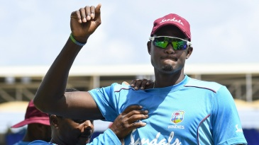 Captain Jason Holder stretches at a training session