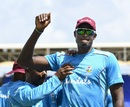 Captain Jason Holder stretches at a training session, Basseterre, July 27, 2018