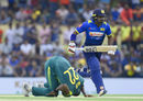Lungi Ngidi tumbles in his followthrough as Kusal Perera steals a run, Sri Lanka v South Africa, 1st ODI, Dambulla, July 29, 2018