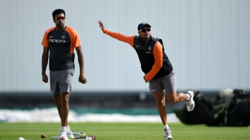 Kuldeep Yadav practices at training as R Ashwin watches