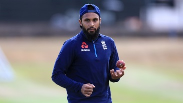 Adil Rashid prepares to bowl during a practice session