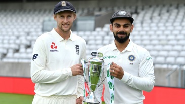 Joe Root and Virat Kohli pose with the trophy