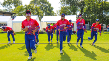 Nepal run onto the field for the start of play in their maiden ODI