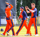 Fred Klaassen gets high-fived by captain Pieter Seelaar after taking a key wicket, Netherlands v Nepal, 1st ODI, Amstelveen, August 1, 2018