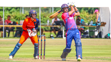 Paras Khadka drives Pieter Seelaar over long-on for six during his maiden ODI fifty