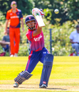 Sompal Kami lofts an elegant drive over extra cover for a boundary, Netherlands v Nepal, 2nd ODI, Amstelveen, August 3, 2018