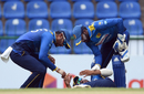 Dhananjaya de Silva and Niroshan Dickwella check on Kusal Mendis after he takes a blow to the hand at slip, Sri Lanka v South Africa, 3rd ODI, Pallekele, August 5, 2018