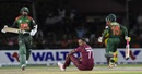 Samuel Badree is down on the ground as Liton Das and Mushfiqur Rahim take a run, West Indies v Bangladesh, 3rd T20I, Lauderhill, August 5, 2018