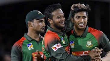 Soumya Sarkar and Shakib Al Hasan celebrate a wicket