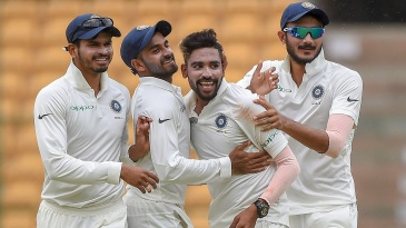 Mohammed Siraj is mobbed by his team-mates