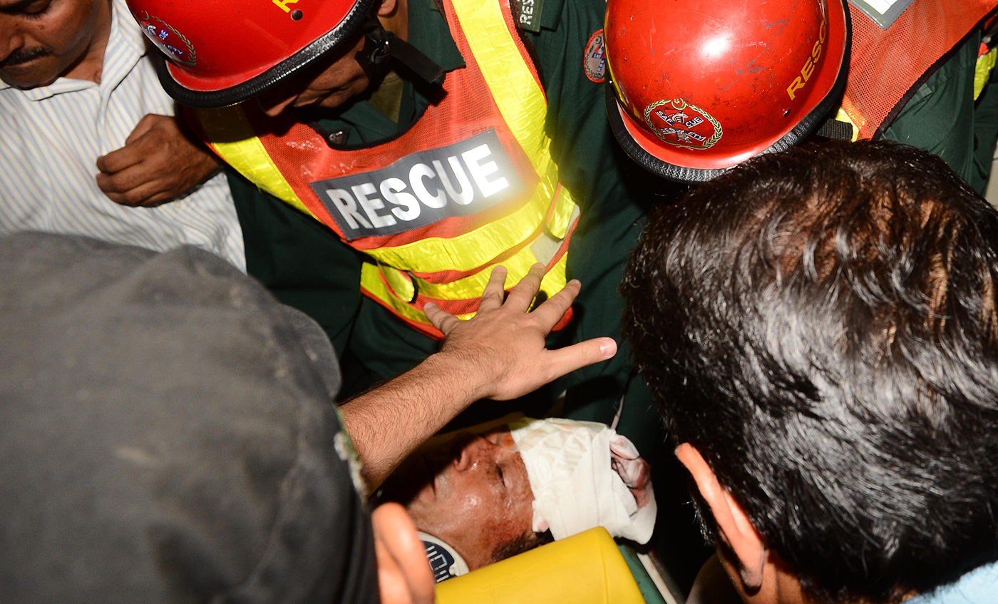 An injured Imran is taken to hospital after he fell off a makeshift elevator during an election rally in Lahore in 2013