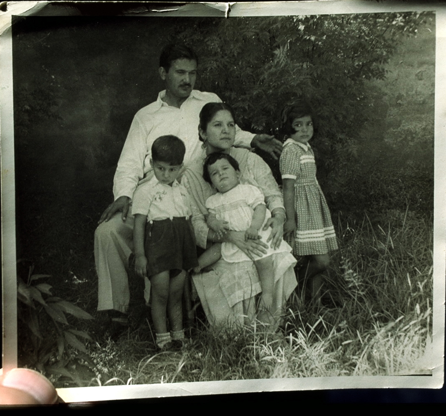 A young Imran with his parents and sisters