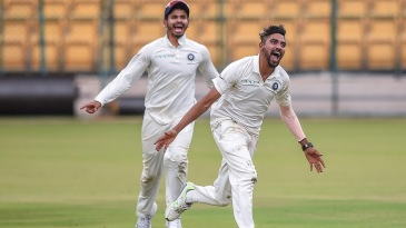 Mohammed Siraj wheels away in celebration