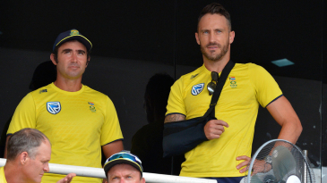 Faf du Plessis looks on from the pavilion