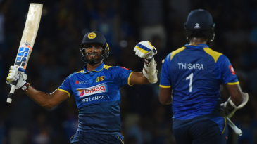 Dasun Shanaka celebrates his fifty