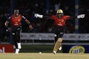Dwayne Bravo and Denesh Ramdin celebrate a wicket, Trinbago Knight Riders v St Lucia Stars, CPL 2018, Port of Spain, August 8, 2018