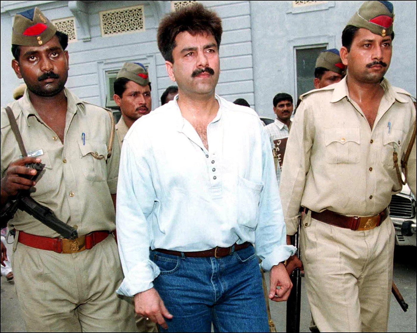 Prabhakar being taken to court for his involvement in a financial scam, New Delhi, 2001