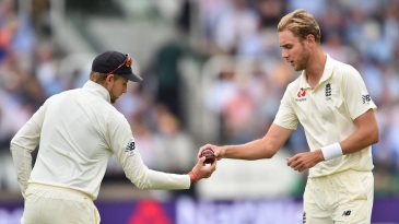 Joe Root hands the ball to Stuart Broad