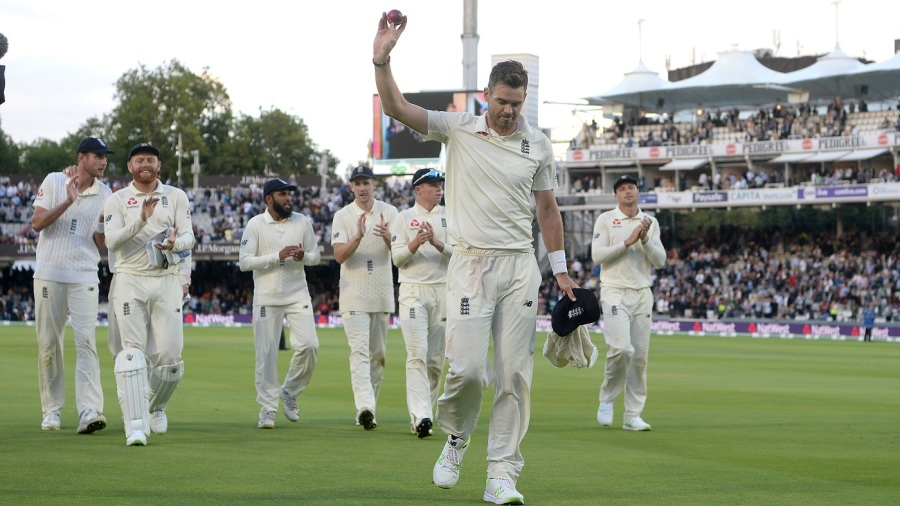 James Anderson raises the ball after his five-wicket haul