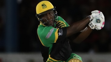 Andre Russell thumps one down the ground