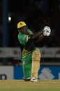 Andre Russell thumps one down the ground, Trinbago Knight Riders v Jamaica Tallawahs, CPL 2018, Port-of-Spain, August 11, 2018