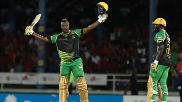 Andre Russell celebrates his hundred