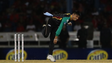 Sandeep Lamichhane bowls during a CPL game
