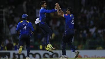 Dhananjaya de Silva and Suranga Lakmal celebrate a wicket