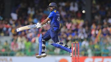 Niroshan Dickwella leaps to play one