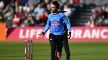 Rashid Khan celebrates a wicket in low-key fashion
