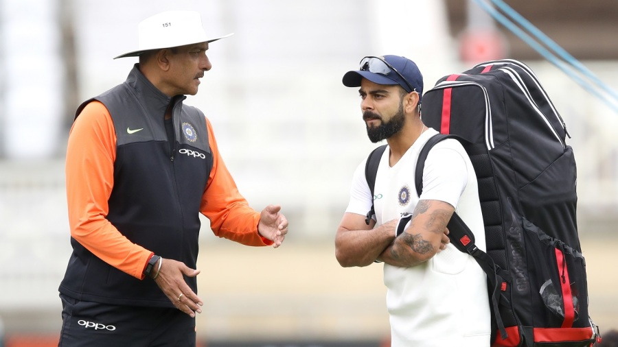 Ravi Shastri and Virat Kohli in discussion during a nets session