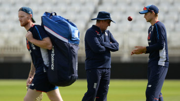 Ben Stokes walks past Trevor Bayliss and Joe Root