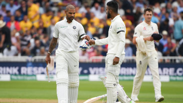 Shikhar Dhawan and KL Rahul bump fists after making it through the opening hour