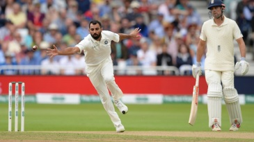 Mohammed Shami stretches to stop the ball
